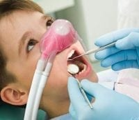 Nitrous oxide being used on young dental patient