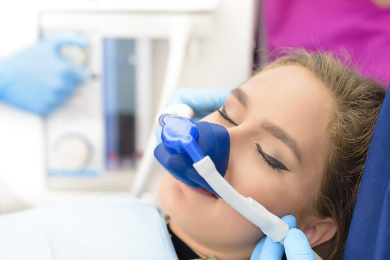 Young patient being sedated before getting dental work done