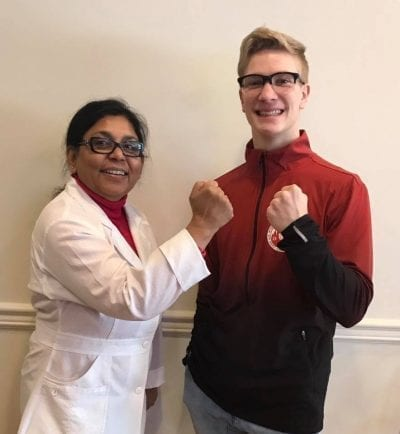 Dr. Kali-Roy dentist in grande prairie with Taekwon-do student Sheldon