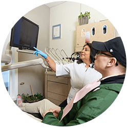 Dental assist showing xray to patient at Grande Prairie Family Dental Clinic