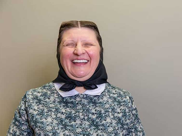 Patient smiling with her new, whiter teeth